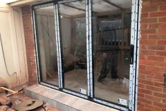 Ada Windows Ltd. Aluminium bifold door installation in Enfield, EN3, North London. Anthracite Grey Bifold